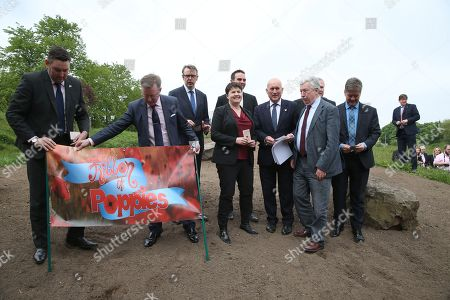 Planting of Holyrood poppy tribute - Miles Briggs and Alexander Stewart position a banner while MSPs, including Ruth Davidson, Leader of the Scottish Conservative and Unionist Party, wait to plant poppy seeds as part of the nationwide Ribbon of Poppies campaign.