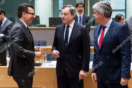Spain's Finance Minister Roman Escolano, left, talks with the President of the European Central Bank Mario Draghi, center, and Eurogroep President Mario Centeno during an eurogroup meeting at the Europa building in Brussels on