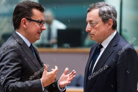 Spain's Finance Minister Roman Escolano, left, talks with the President of the European Central Bank Mario Draghi during an eurogroup meeting at the Europa building in Brussels on