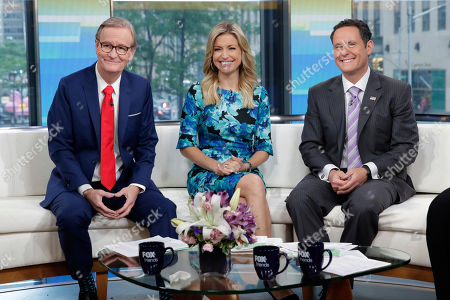 "Steve Doocy, Ainsley Earhardt, Brian Kilmeade. Co-hosts Steve Doocy, Ainsley Earhardt, and Brian Kilmeade, left to right, of the ""Fox & friends"" television program, appear on their ""curvy couch"" in New York"