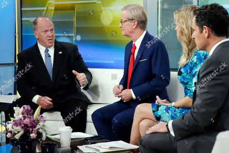"Steve Doocy, Ainsley Earhardt, Brian Kilmeade, Thomas Homan. Acting Director of U.S. Immigration and Customs Enforcement Thomas Homan, left, is interviewed on the ""Fox & Friends"" television program by co-hosts Steve Doocy, second from left, Ainsley Earhardt, and Brian Kilmeade, right, in New York"