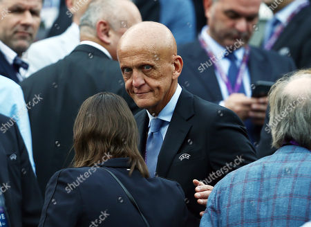 Former referee Pierluigi Collina looks on from the stand