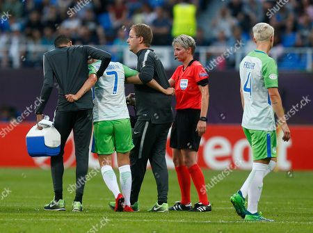 Stock Photo of Team medics help carry Wolfsburg's Sara Bjork Gunnarsdottir, center, off the pitch during the the UEFA Women's Champions League Final soccer match between Lyon and Wolfsburg at the Valeriy Lobanovskiy stadium in Kiev, Ukraine