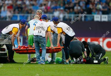 Medics attend to Wolfsburg's Sara Bjork Gunnarsdottir on the pitch during the the UEFA Women's Champions League Final soccer match between Lyon and Wolfsburg at the Valeriy Lobanovskiy stadium in Kiev, Ukraine