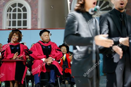 Rita Dove, John Lewis. Rita Dove, left, and U.S. Rep. John Lewis, listen as a student and alumni group performs a newly commissioned work to honor Lewis during Harvard University commencement exercises, in Cambridge, Mass