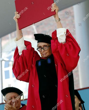 Stock Photo of Twyla Tharp holds up her honorary Doctor of Arts degree during Harvard University commencement exercises, in Cambridge, Mass