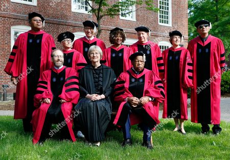 Stock Image of Drew Faust, Alan Garber, John Lewis, George Emmanuel Lewis, Twyla Tharp, Harvey Vernon Fineberg, Rita Dove, Ricardo Lagos, Sallie Watson Chisholm, Wong Kar Wai. Harvard University President Drew Faust, front center, sits with provost Alan Garber, front left, and U.S. Rep. John Lewis, front right, while honorary degree recipients, from left, George Emmanuel Lewis, Twyla Tharp, Harvey Vernon Fineberg, Rita Dove, Ricardo Lagos, Sallie Watson Chisholm and Wong Kar Wai stand behind, before commencement exercises at Harvard, in Cambridge, Mass