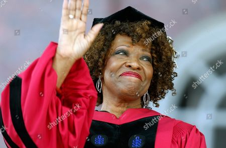 Stock Image of Rita Dove waves during Harvard University commencement exercises, in Cambridge, Mass