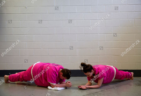 Stock Picture of Lauren Jones, Blanche Ball. Inmates Blanche Ball, left, and Lauren Jones do planks while exercising at the Campbell County Jail in Jacksboro, Tenn. On their one hour outside their cell, they can visit an exercise room, but it has no equipment so the women improvise