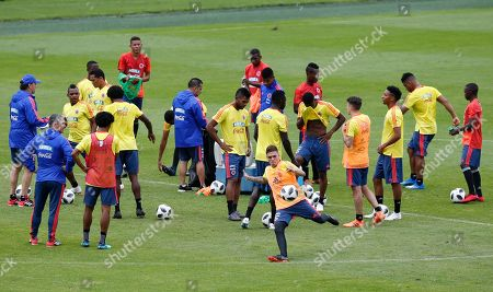 Colombia's soccer player Juan Fernando Quintero, front center, kicks the ball during a practice session in preparation for the World Cup in Russia, at El Campin stadium in Bogota, Colombia