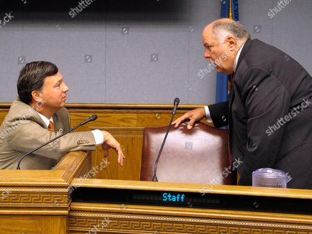 House Ways and Means Chairman Neil Abramson, D-New Orleans, left, speaks with the committee's vice chairman, Rep. Jim Morris, R-Oil City, ahead of the committee's tax debate, in Baton Rouge, La