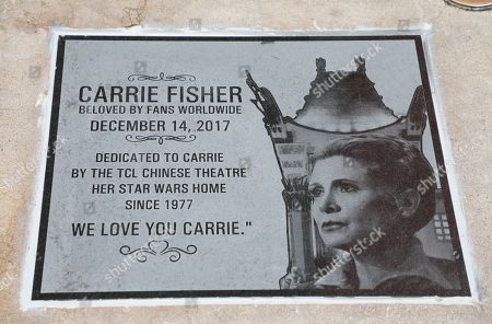 Stock Photo of 'Star Wars' actress Carrie Fisher is memorialized with a just-unveiled, etched granite plaque at the TCL Chinese Theatre in Hollywood, California, USA, 24 May 2018. The theatre forecourt holds the embedded handprints and footprints of many celebrities, but this is the first time a movie star has been honored in this way.