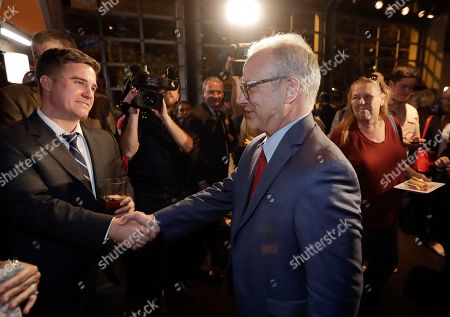 Nashville Mayor David Briley, center, is congratulated after winning a special election to remain as mayor, in Nashville, Tenn. Briley took over as the city's mayor in early March after Megan Barry resigned from her position as part of a plea agreement for felony theft charges