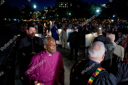 The Most Rev. Michael Curry, center left, the presiding bishop of the U.S. Episcopal Church, who spoke at the royal wedding of Prince Harry and Meghan Markle, and others take part in a candlelight vigil outside the White House, in Washington. According to organizers, the event was intended to bring attention to political, moral and theological issues in America