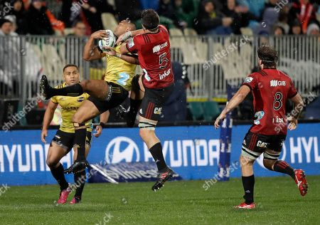 Hurricanes Julian Savea is tackled by Crusaders Quinten Strange during their Super Rugby match in Christchurch, New Zealand