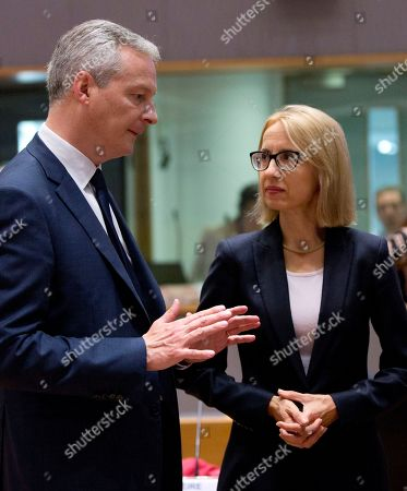 French Finance Minister Bruno Le Maire, left, speaks with Polish Finance Minister Teresa Czerwinska during a meeting of EU finance ministers at the Europa building in Brussels on