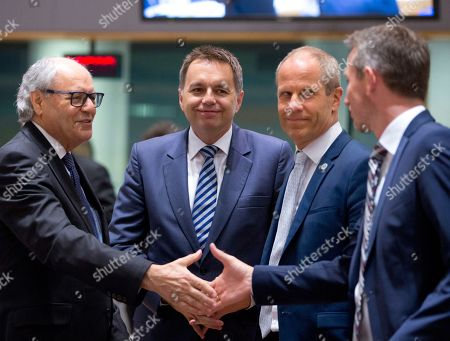 Malta's Finance Minister Edward Scicluna, left, greets Danish Finance Minister Kristian Jensen, right, during a meeting of EU finance ministers at the Europa building in Brussels on