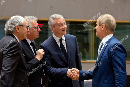 French Finance Minister Bruno Le Maire, center, greets Estonian Finance Minister Toomas Tonist, right, during a meeting of EU finance ministers at the Europa building in Brussels on . At left is Malta's Finance Minister Edward Scicluna and second left is Luxembourg's Finance Minister Pierre Gramegna