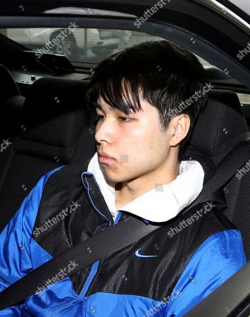 Stock Photo of Yu 'Sunny' Zhang is escorted by police after being extradited from New South Wales to Queensland on arrival at the Southport Watchhouse on the Gold Coast, Queensland, Australia, 25 May 2018. Zhang is expected to become the second person charged over the 11 May kidnapping of a 12-year-old-boy on the Gold Coast after his father Zheng Jie Zhang, 53, was denied bail at Southport Magistrates Court last week.