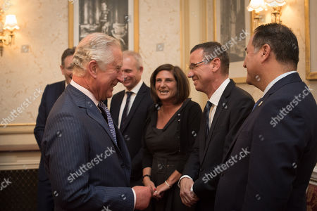 Prince Charles meets Ambassador Mark Regev, watched by Jonathan M. Goldstein, David Lidington, Louise Jacobs, and Israel Maimon.