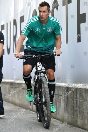 Germany's assistant coach Miroslav Klose on a bike after a training session in Eppan, Italy, 25 May 2018. The German squad prepares for the upcoming FIFA World Cup 2018 soccer championship in Russia at a training camp in Eppan, South Tyrol, until 07 June 2018.
