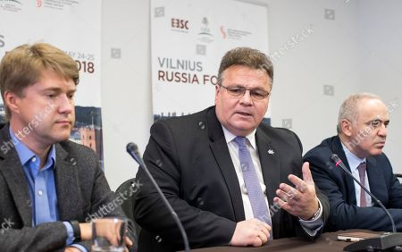 Linas Linkevicius, ladimir Ashurkov, Garry Kasparov. Lithuania's Minister of Foreign Affairs Linas Linkevicius, center, speaks as Russian opposition politician Vladimir Ashurkov, left, and Prominent Russian opposition figure and chess champion Garry Kasparov listen during a news conference at the end of a fifth Vilnius Russia Forum at the Esperanza hotel in Trakai district, some 50 kms (31 miles) west of the capital Vilnius, Lithuania, . The annual forum discusses topical issues of Russian domestic and foreign policy