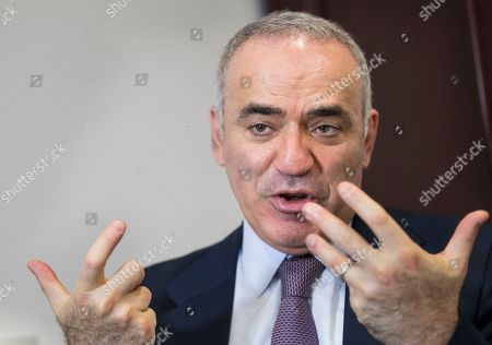 Prominent Russian opposition figure and chess champion Garry Kasparov speaks in an interview with The Associated Press at the conclusion of the fifth Vilnius Russia Forum at the Esperanza hotel in Trakai district,some 50 kms (31 miles) west of the capital Vilnius, Lithuania
