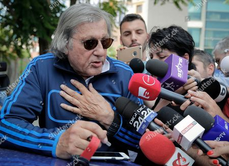 Former tennis player Ilie Nastase gestures while speaking to media after being released from the traffic police headquarters in Bucharest, Romania, following his second arrest within hours, first on suspicion of driving while drunk and refusing to take a breathalyzer test, and then for riding a scooter without a license and breaking traffic law. Bucharest traffic police head Victor Gilceava said Nastase had a level of 0.55 mg of alcohol per liter, an offense that carries a a maximum five-year prison sentence