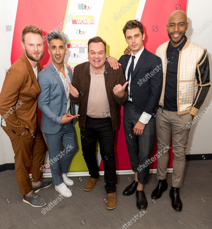 Stock Image of Queer Eye for the Straight Guy - Tan France, Antoni Porowski, Karamo Brown and Bobby Berk with Shaun Williamson
