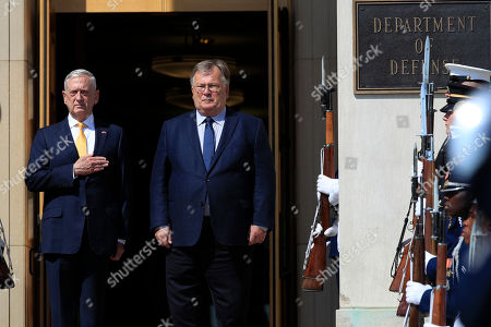 Jim Mattis, Claus Hjort Frederiksen. Secretary of Defense Jim Mattis, puts his hand over his heart as the Star Spangled Banner is played during a ceremony welcoming Denmark's Minister of Defense Claus Hjort Frederiksen, at the Pentagon
