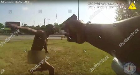 This still image taken from the Richmond, Va., Police body camera shows a police officer pointing his gun at Marcus-David Peters, in Richmond, Va. Police Chief Alfred Durham on Friday, May 25, released the video showing the officer first used a stun gun when Peters approached him. Police say it was not effective and the officer then shot Peters twice in the abdomen