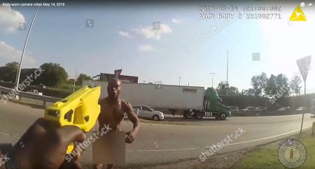 This still image taken from the Richmond, Va., Police body camera shows Richmond Police officer holding a stun gun at Marcus-David Peters approaches him on in Richmond, Va. Police Chief Alfred Durham on Friday, May 25 released the video showing the officer first used the stun gun when Peters approached him. Police say it was not effective and the officer then shot Peters twice in the abdomen