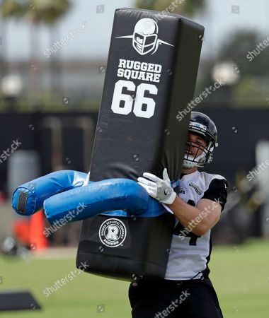 Jacksonville Jaguars free safety Charlie Miller runs a drill during an NFL football practice, in Jacksonville, Fla