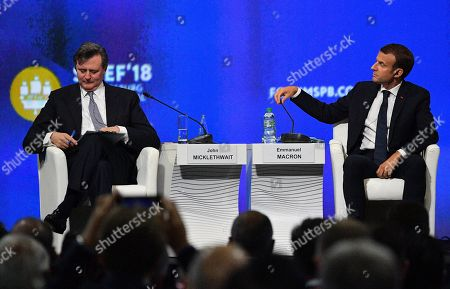 French President Emmanuel Macron and Bloomberg News Chief Editor John Micklethwait attending a session of the Saint Petersburg International Economic Forum