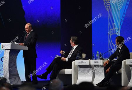 Russian President Vladimir Putin, French President Emmanuel Macron and John Micklethwait chief editor of Bloomberg News attending a session of the Saint Petersburg International Economic Forum