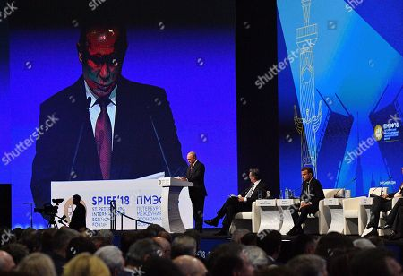 Stock Picture of Russian President Vladimir Putin, French President Emmanuel Macron and John Micklethwait chief editor of Bloomberg News attending a session of the Saint Petersburg International Economic Forum