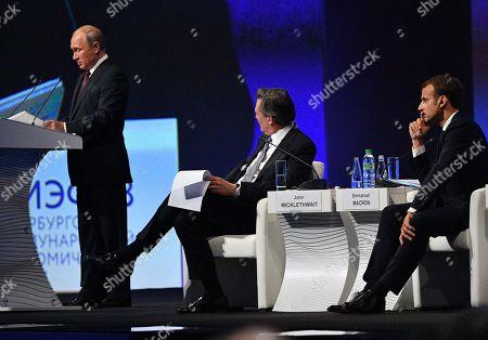Stock Photo of Russian President Vladimir Putin, French President Emmanuel Macron and John Micklethwait chief editor of Bloomberg News attending a session of the Saint Petersburg International Economic Forum