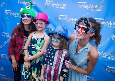 Samantha Busch is seen greeting fans at the Walmart Family Mobile tent during the Speed Street festival, in Charlotte, N.C