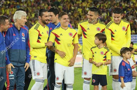 Colombian national soccer team players Radamel Falcao (2R), James Rodriguez (R), Juan Fernando Quintero (C), singer Maluma (2L) and head coach Jose Pekerman (L) talk prior to the farewell game at Nemesio Camacho El Campin stadium in Bogota, Colombia, 25 May 2018. Colombia is preparing to compete in the 2018 Russia World Cup as part of group H.