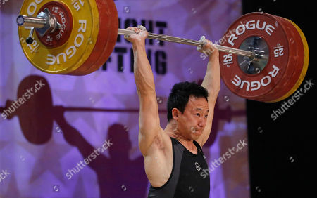Combined winner Alex Lee lifts in the clean & jerk portion of the men's +69kg competition of the USA Nation Weightlifting Championships, in Overland Park, Kan