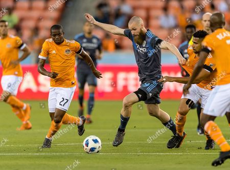 Houston Dynamo midfielder Oscar Garcia (27) chases the ball as New York City forward Jo Inge Berget (9)] keeps control during a match between the New York City FC and the Houston Dynamo on , at BBVA Compass Stadium in Houston, Texas The score is tie at the half 1-1