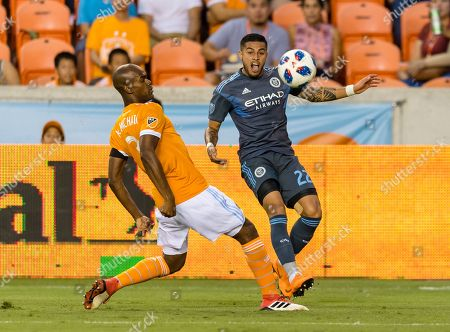 New York City defender Ronald Matarrita (22) and Houston Dynamo defender Adolfo Machado (3) battle for the ball during a match between the New York City FC and the Houston Dynamo on , at BBVA Compass Stadium in Houston, Texas The score is tie at the half 1-1