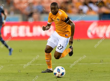 Houston Dynamo midfielder Oscar Garcia (27) controls the ball during a match between the New York City FC and the Houston Dynamo on , at BBVA Compass Stadium in Houston, Texas The score is tie at the half 1-1
