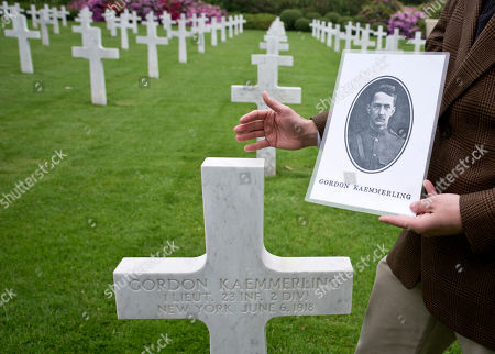 Superintendent of the Aisne Marne Cemetery, Shane Williams, holds a photo of World War I soldier Lt. Gordon Kaemmerling as he stands in front of his headstone at the World War I Aisne Marne cemetery in Belleau, France. The World War I battle of Bellau Wood in northern France pitted untested U.S. forces against the more-experienced Germans, who were making a push toward Paris. It became a defining moment, proving the Americans' military mettle and helping turn the tide of the war