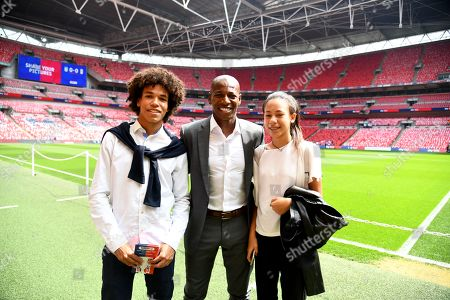 Ex-Fulham player Luis Boa Morte with his family before the game on the Wembley pitch