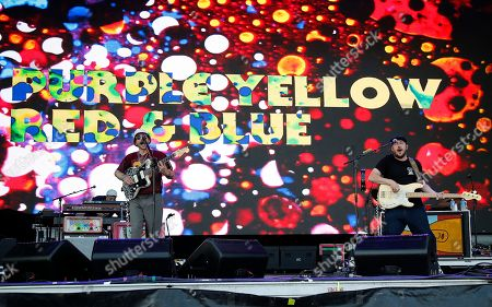 Kyle O'Quin, John Gourley, Zachary Scott Carothers. Kyle O'Quin, from left, John Gourley, and Zachary Scott Carothers of Portugal. The Man perform at the Boston Calling Music Festival, in Allston, Mass