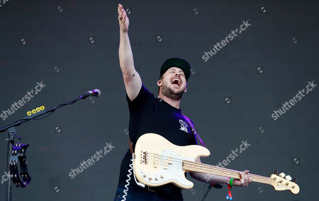 Portugal. The Man bass guitarist Zachary Scott Carothers performs at the Boston Calling Music Festival, in Allston, Mass