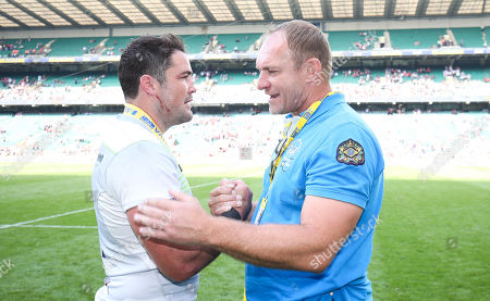 Brad Barritt of Saracens talks with Francois Pienaar (SA Rugby - World Cup Winner) after victory Saracens' victory celebrations on pitch and in changing room