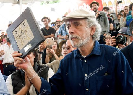 Spanish film director Fernando Trueba shows a award during his visit to Cans Festival in Cans, Galicia, Spain, 26 May 2018.
