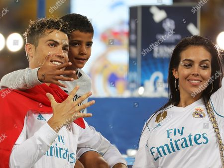 Cristiano Ronaldo of Real Madrid and his son Cristiano Ronaldo Jr. and girlfriend Georgina Rodriguez celebrate after the UEFA Champions League final between Real Madrid and Liverpool FC at the NSC Olimpiyskiy stadium in Kiev, Ukraine, 26 May 2018. Madrid won 3-1.